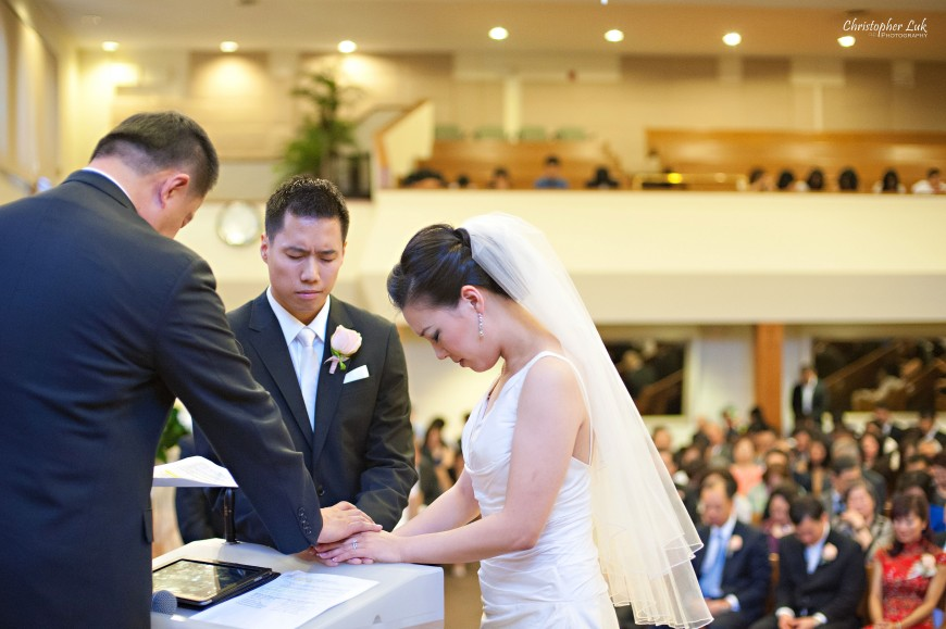 Christopher Luk Wedding 2012 - Joy and Darrick - Yum Kwang Presbyterian Church Toronto The Bellagio Vaughan Ontario - Bride and Groom Altar Ceremony Officiant Dad Father Prayer Praying Hands Christian Marriage