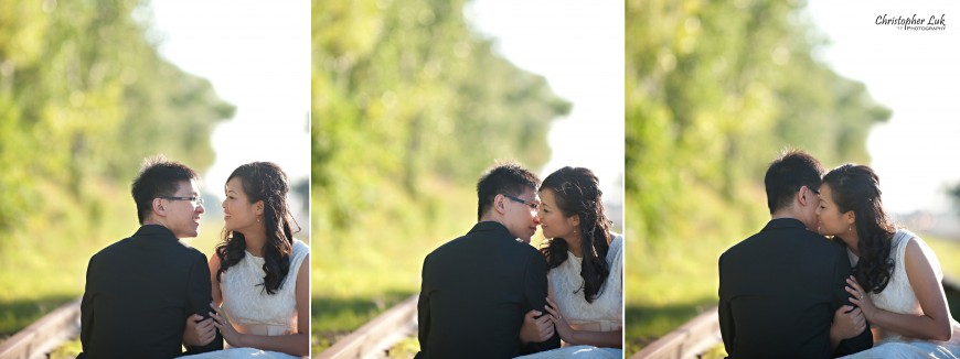Christopher Luk 2012 - Engagement Session - Keren and Mat - Cherry Beach Historic Distillery District - Toronto Wedding Lifestyle Lifetime Photographer - Railway Railroad Train Tracks Almost Kiss Laugh Smile
