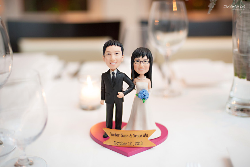 Christopher Luk 2013 - Grace and Victor's Wedding - Sassafraz Restaurant Yorkville Royal Ontario Museum Downtown Toronto Event Photographer - Bride and Groom Sculpture Bust Bobblehead Doll Display