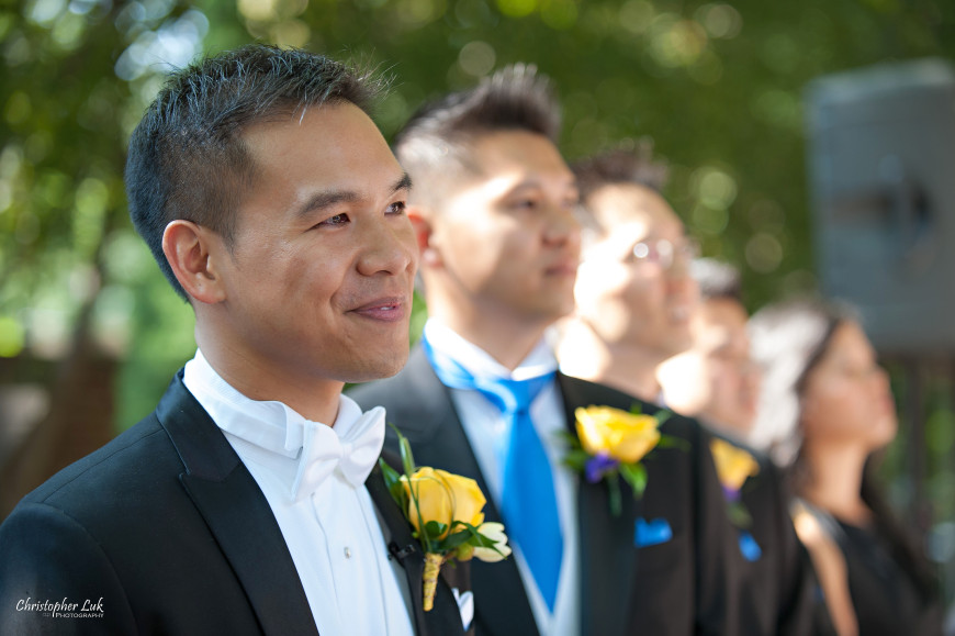 Christopher Luk 2013 - Victoria and Wallace's Wedding - Outdoor Summer Garden Wedding - Sala Caboto at The Columbus Event Centre - Groom Ceremony Reaction Waiting for the Bride to Walk Down the Aisle Groomsmen