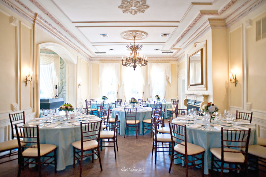 Christopher Luk - Toronto Wedding Portrait Event Photographer - Graydon Hall Manor - Blue Main Hall Room Wide Overview Chiavari Chairs Centrepieces Flatware Glassware Linens Tablecloths Flowers Floral Arrangements Mirror Chandelier Hardwood Floor Fireplace Mantel Crown Moulding