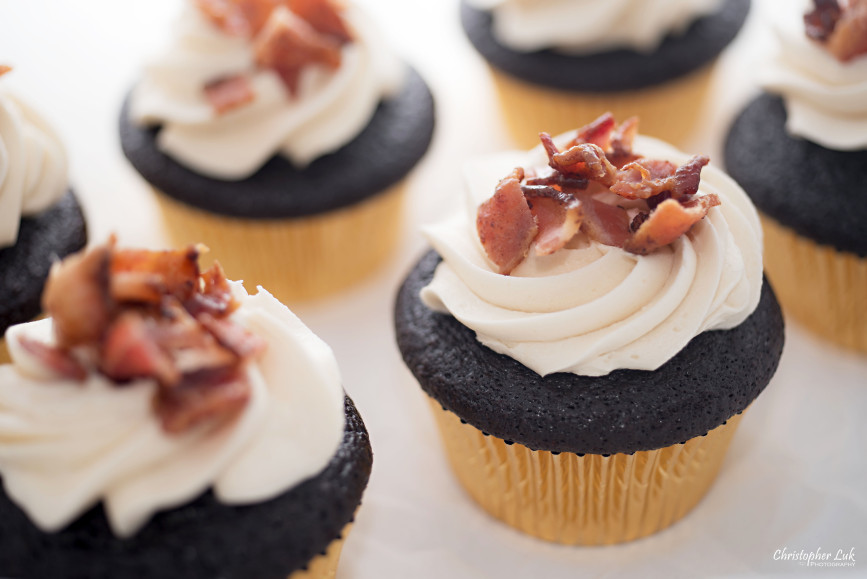 Christopher Luk 2014 - Cakelette Bakeshop - Valentine's Day Maple Candied Bacon Chocolate Cupcakes with Gold Foil On White Multiple Half Dozen Group Layout