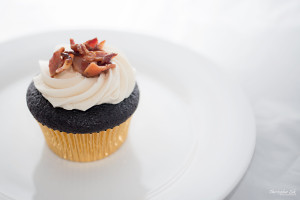 Christopher Luk 2014 - Cakelette Bakeshop - Valentine's Day Maple Candied Bacon Chocolate Cupcakes with Gold Foil White Plate Hero Shot