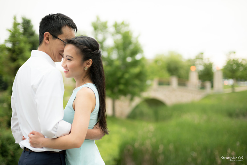 Christopher Luk Engagement Session 2015 - Ying Ying and Alvin - Richmond Hill Green Park Markham York Region - Bride Groom Relaxed Creative Portrait Candid Natural Photojournalistic Hug Kiss Smile Bridge Trees Landscape
