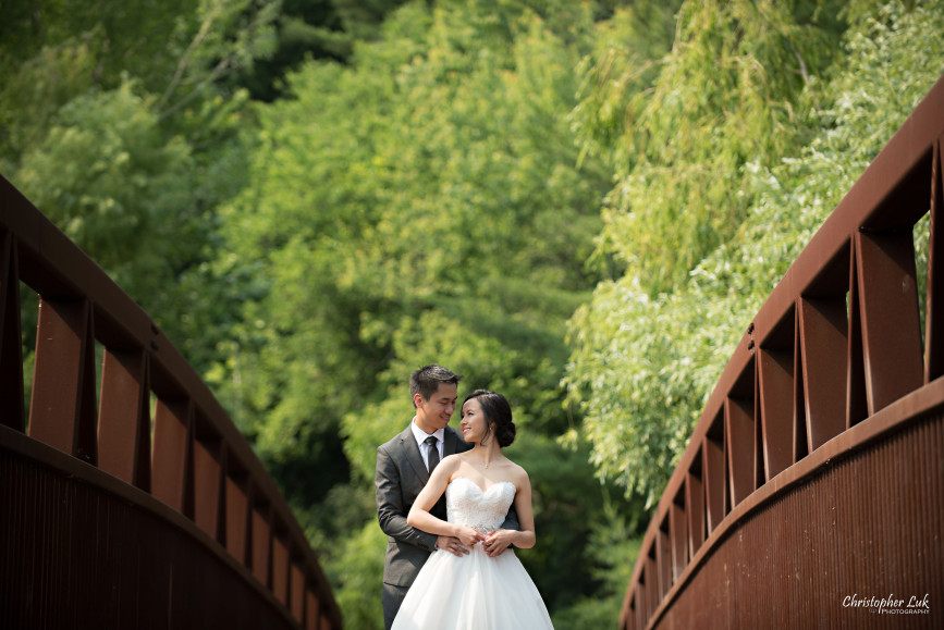 Christopher Luk 2015 - Karen and Scott's Wedding - Miller Lash House University Toronto Scarborough UTSC Outdoor Summer Ceremony Reception - Bride Groom Photojournalistic Candid Natural Relaxed Hug Bridge