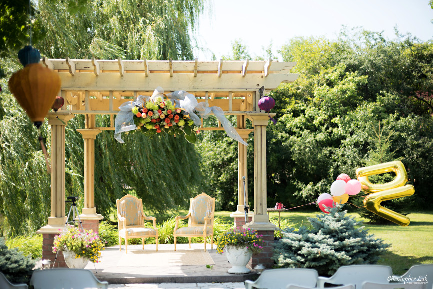 Christopher Luk 2015 - Vannessa and Daniel's Brampton Summer Outdoor Backyard Tea Ceremony Family Wedding Engagement Party Celebration - Gazebo Patio Covering Ornate Chairs Centrepiece Glass Bowl Flowers Crystals Details Floral Arrangement Initials Monogram Floating Flying Helium Balloons Letters