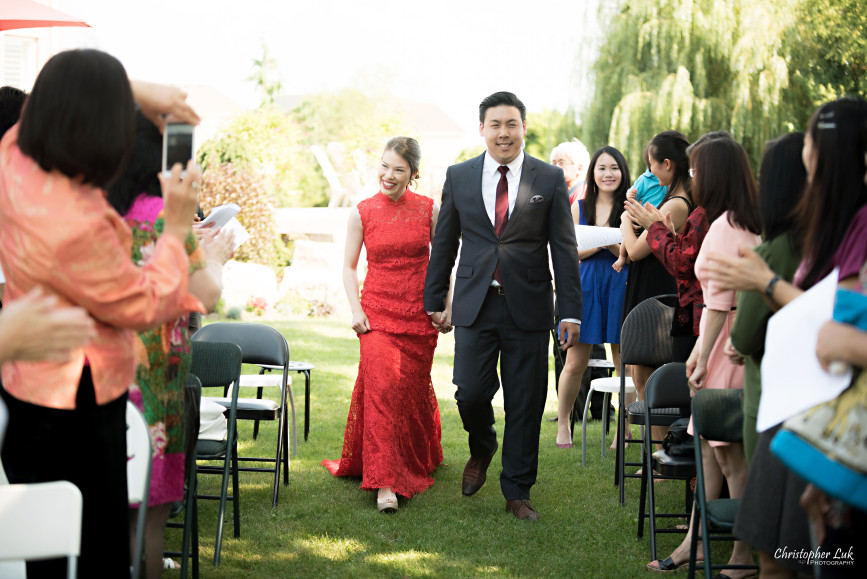 Christopher Luk 2015 - Vannessa and Daniel's Brampton Summer Outdoor Backyard Tea Ceremony Family Wedding Engagement Party Celebration - Bride Groom Navy Blue Suit Asian Red Dress Walking Down the Aisle Ceremony Processional Candid Photojournalistic