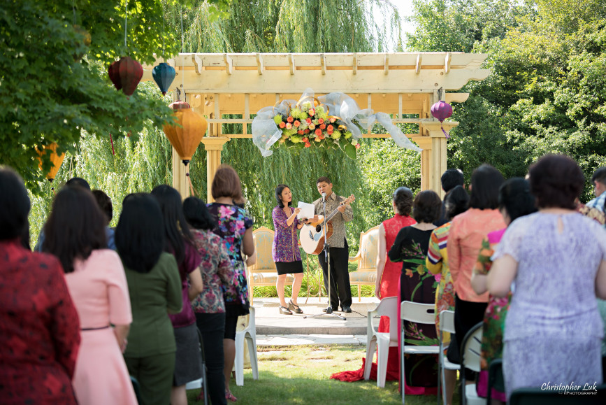 Christopher Luk 2015 - Vannessa and Daniel's Brampton Summer Outdoor Backyard Tea Ceremony Family Wedding Engagement Party Celebration - Christian Singing Worship Guitar Gazebo Chairs People Guests Family