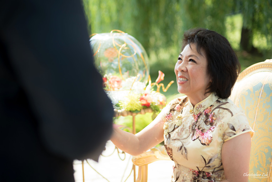 Christopher Luk 2015 - Vannessa and Daniel's Brampton Summer Outdoor Backyard Tea Ceremony Family Wedding Engagement Party Celebration - Bride Groom Navy Blue Suit Asian Red Dress Tea Ceremony Smile Laugh Candid Photojournalistic Mother Gold Dress