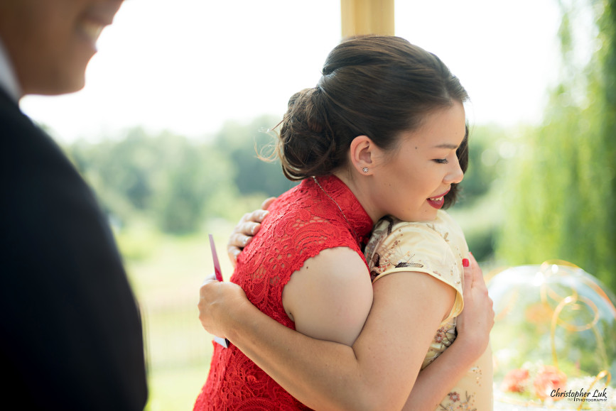 Christopher Luk 2015 - Vannessa and Daniel's Brampton Summer Outdoor Backyard Tea Ceremony Family Wedding Engagement Party Celebration - Bride Groom Navy Blue Suit Asian Red Dress Tea Ceremony Smile Laugh Candid Photojournalistic Mother Daughter Hug