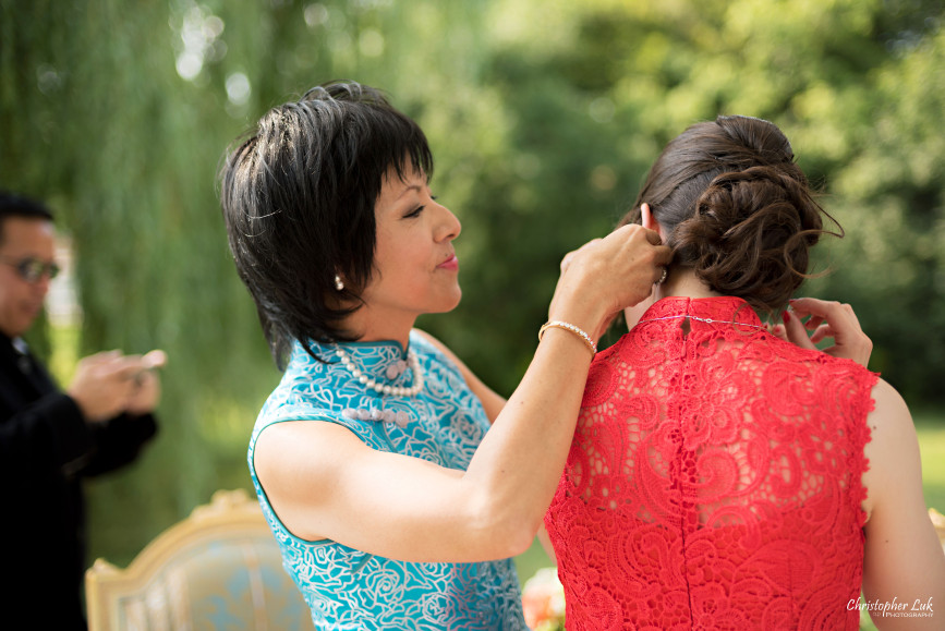 Christopher Luk 2015 - Vannessa and Daniel's Brampton Summer Outdoor Backyard Tea Ceremony Family Wedding Engagement Party Celebration - Bride Groom Navy Blue Suit Asian Red Dress Tea Ceremony Smile Laugh Candid Photojournalistic Mother Daughter in Law Jewellery Jewelry Earrings Gold
