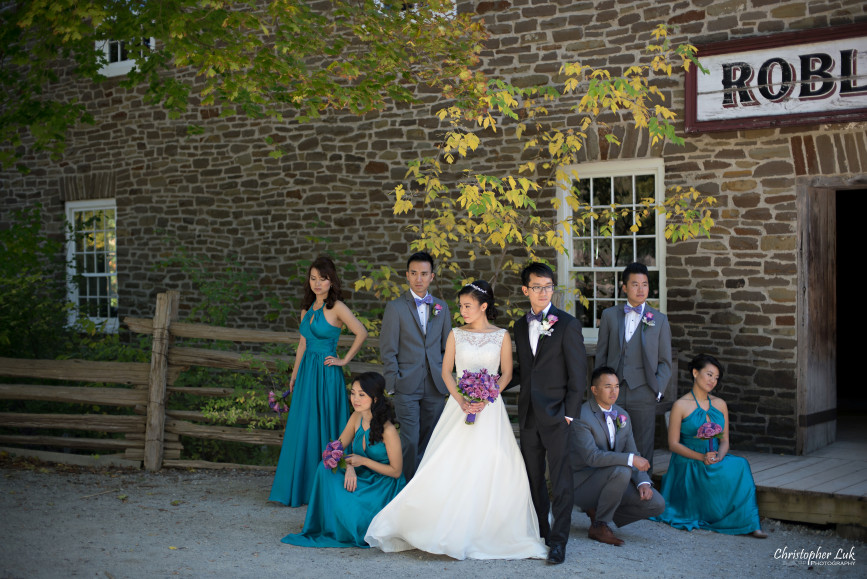 Fall Autumn Wedding Creative Relaxed Portrait Session Photojournalistic Candid Natural Posed Black Creek Pioneer Village Bride Bridesmaids Floral Bouquets Groomsmen Old Mill Entrance Bridal Party Group