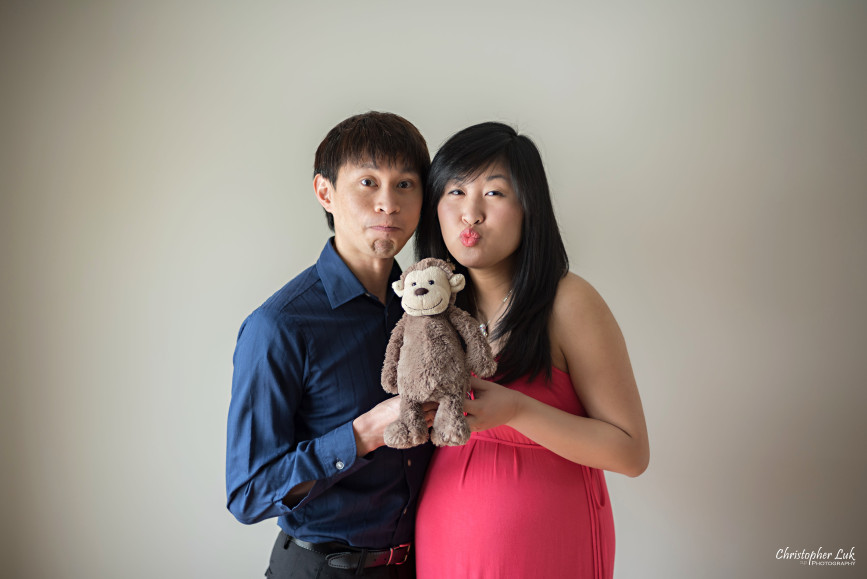 Husband Wife Mom Dad Maternity Belly Baby Bump Family Photojournalistic Candid Natural Posed Relaxed Stuffed Animal Monkey Funny Faces