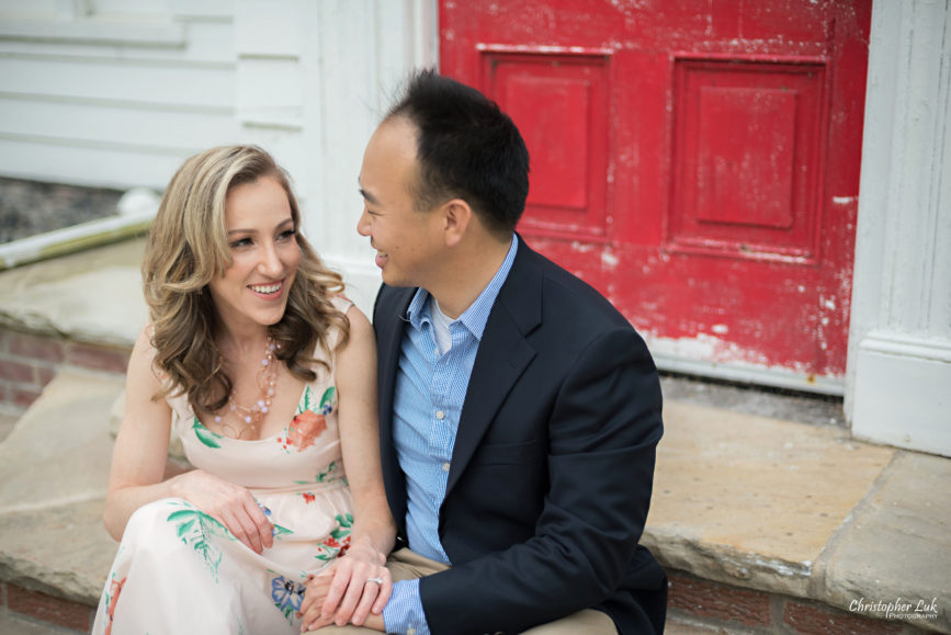 Christopher Luk (Toronto Wedding Portrait Event Photographer) - Photojournalistic Candid Natural Engagement Session Adamson Estate Royal Conservatory of Music Mississauga Bride Groom Sitting Laughing Red Door