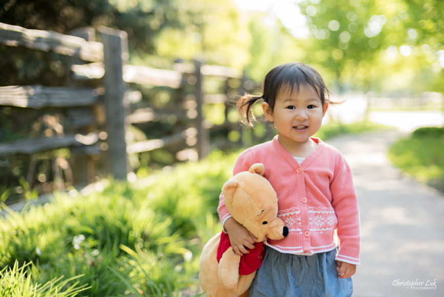 Christopher Luk (Toronto Wedding Portrait Event Photographer): Infant Toddler Children Parents Grandparents Family Pictures Photography Session Photojournalistic Candid Natural Daughter Baby Girl Hug Squeeze Winnie The Pooh Stuffed Animal Toy
