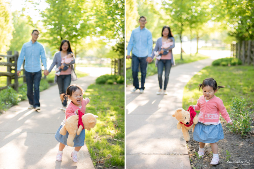 Christopher Luk (Toronto Wedding Portrait Event Photographer): Infant Toddler Children Parents Grandparents Family Pictures Photography Session Photojournalistic Candid Natural Father Daddy Mother Mommy Daughter Baby Girl Holding Winnie the Pooh Stuffed Animal Toy Running Playing Path