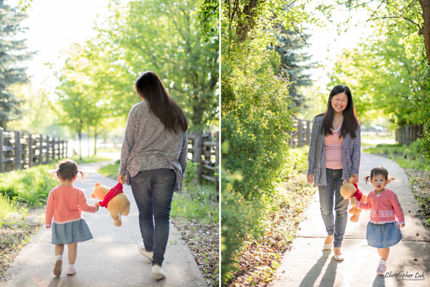 Christopher Luk (Toronto Wedding Portrait Event Photographer): Infant Toddler Children Parents Grandparents Family Pictures Photography Session Photojournalistic Candid Natural Mother Mommy Daughter Baby Girl Holding Winnie the Pooh Stuffed Animal Toy Walking