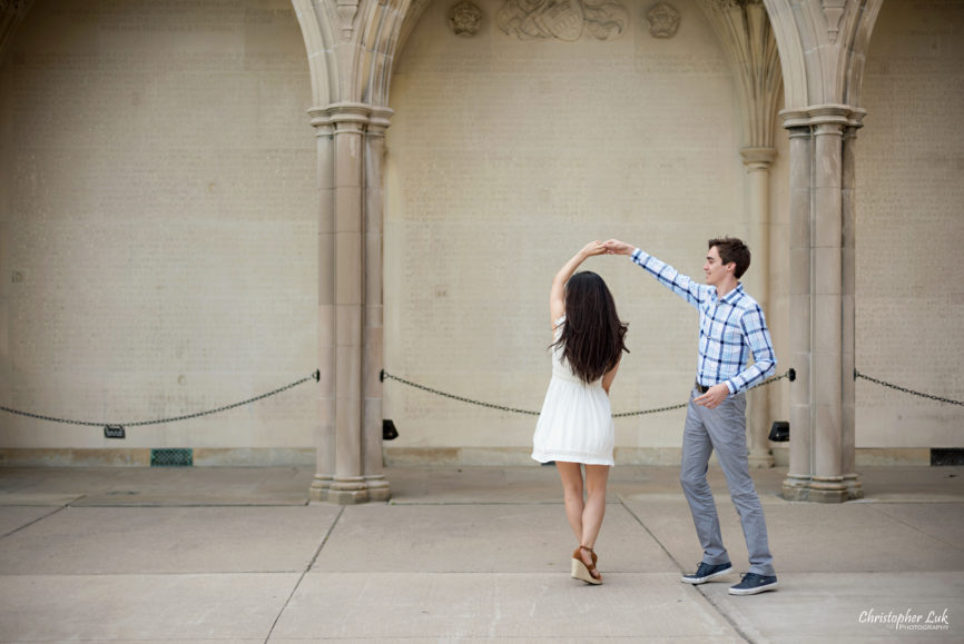 Christopher Luk (Toronto Wedding, Lifestyle & Event Photographer): Cindy and Matthew's University of Toronto Downtown Engagement Session - Bride Groom Natural Candid Photojournalistic University College Memorial Archway Twirl Spin
