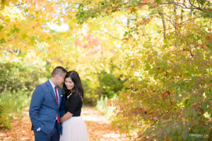 Christopher Luk - Toronto Vaughan Wedding Portrait Corporate Lifestyle Event Engagement Session PreWedding Photographer - The Doctor's House Main Street Kleinburg Conservation Woods Park Autumn Fall Leaves Bride Groom Pink Tulle Skirt Blue Suit Red Tie Golden Glowing Forest Trees Hug