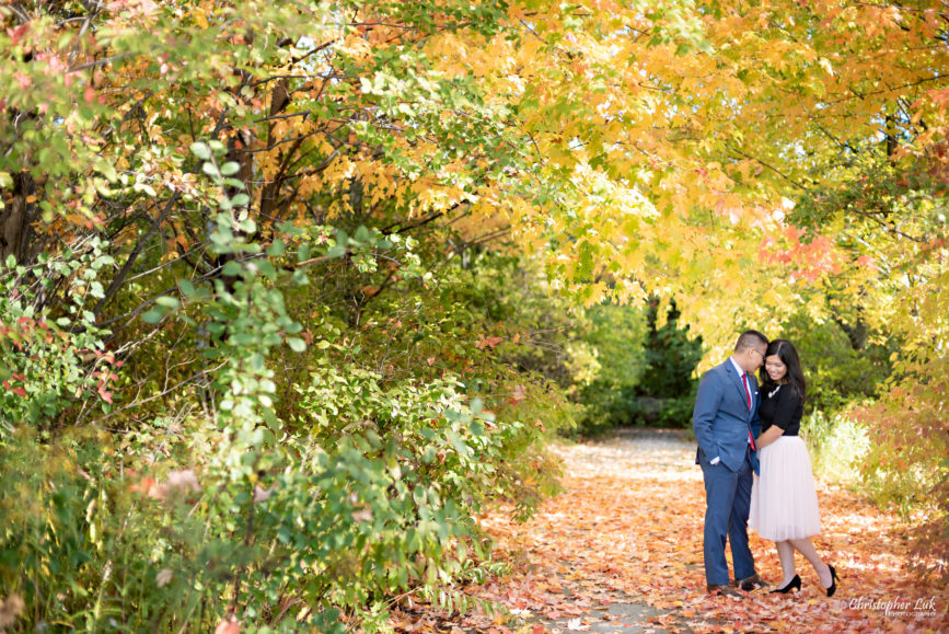 Christopher Luk - Toronto Vaughan Wedding Portrait Corporate Lifestyle Event Engagement Session PreWedding Photographer - The Doctor's House Main Street Kleinburg Conservation Woods Park Autumn Fall Leaves Bride Groom Pink Tulle Skirt Blue Suit Red Tie Golden Glowing Forest Trees Hug Tunnel Pathway Red Walking Path