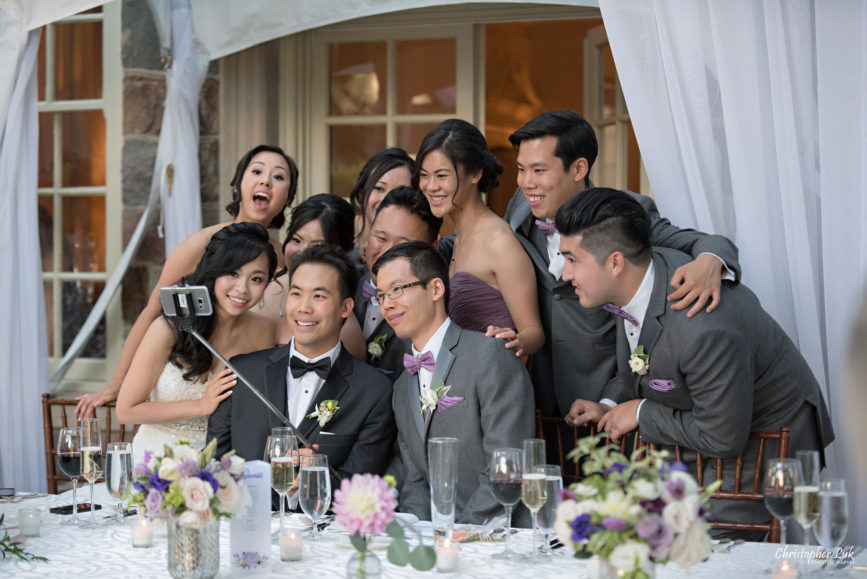 Christopher Luk (Toronto Wedding Photographer): Christine and Jonathan's Wedding - Graydon Hall Manor Toronto Foodie Summer Outdoor Garden Ceremony Patio Terrace Tent Dinner Reception Evening Mansion Estate Exterior Stone Dinner Candid Natural Photojournalistic Bridal Party Kissing Game Group Selfie Stick