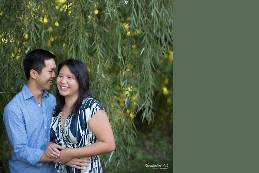 Christopher Luk (Toronto Wedding Engagement Session Photographer): Main Street Unionville TooGood Pond Markham - Bride Groom Candid Natural Photojournalistic Portrait Willow Tree Leaves Smile Whisper Hug