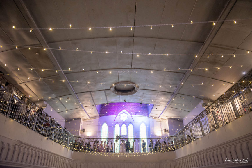 Christopher Luk (Toronto Wedding Photographer): Berkeley Church Vintage Rustic Ceremony Candlelight Dinner Reception Pinterest Worthy Details Candid Natural Photojournalistic Bride Groom Hanging Christmas Lights Bulbs Mezzanine Balcony Wide