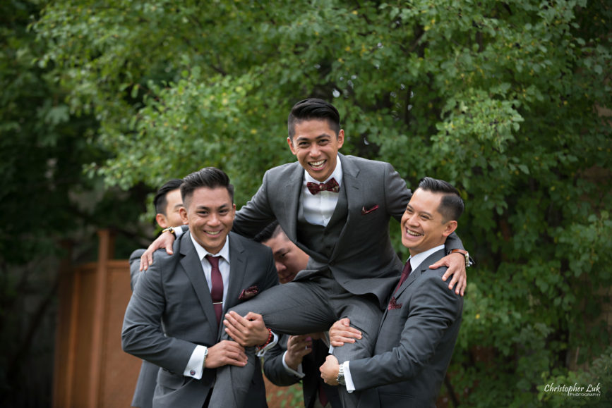 Christopher Luk Toronto Wedding Portrait Lifestyle Event Photographer - Eagles Nest Golf Club Outdoor Ceremony Toronto Raptors Blue Jays Sports Fans Candid Natural Photojournalistic Groom Groomsmen JCrew J Crew Grey Suits Funny Fun Laughing Carried