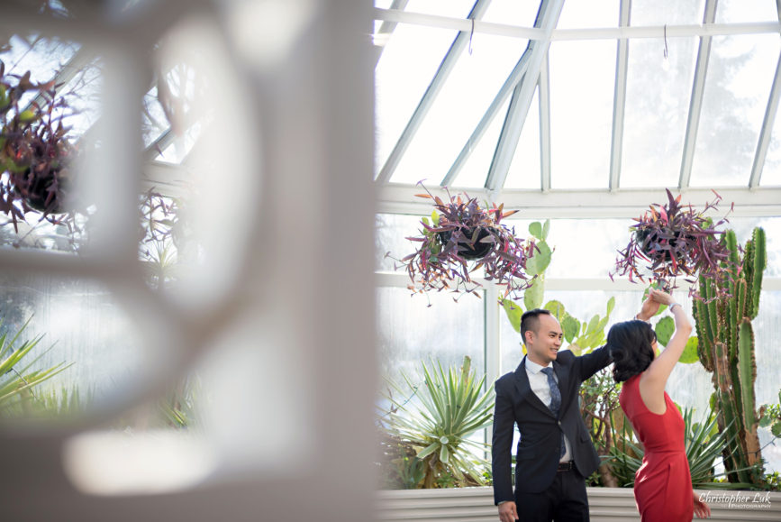 Christopher Luk (Toronto Wedding Photographer): Winter Indoor Engagement Session PreWedding Pictures Heintzman House Photos Markham York Region Natural Candid Photojournalistic Bride Groom Greenhouse Dancing Twirl Spin