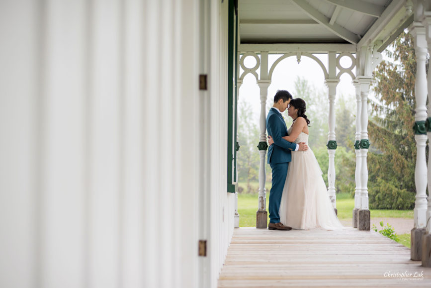 Christopher Luk: Toronto Wedding Photographer: Markham Museum Scarborough Chinese Baptist Church SCBC Columbus Event Centre Sala Caboto Natural Candid Photojournalistic Bride Groom Portrait Hug Holding Each Other Close Leading Lines Historic White Wood Home Burkholder House Covered Porch Verandah Wide
