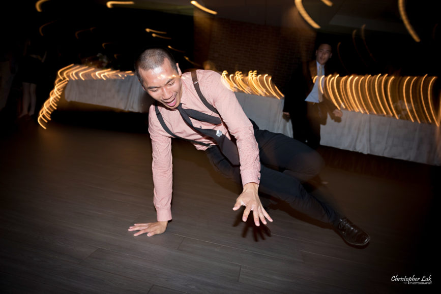 Christopher Luk - Toronto Wedding Photographer - The Manor Event Venue By Peter and Paul's - Cocktail Hour & Dinner Reception Candid Natural Photojournalistic Guests Friends Family Dancing Dance Moves Floor Fun Floor Spin Spinning
