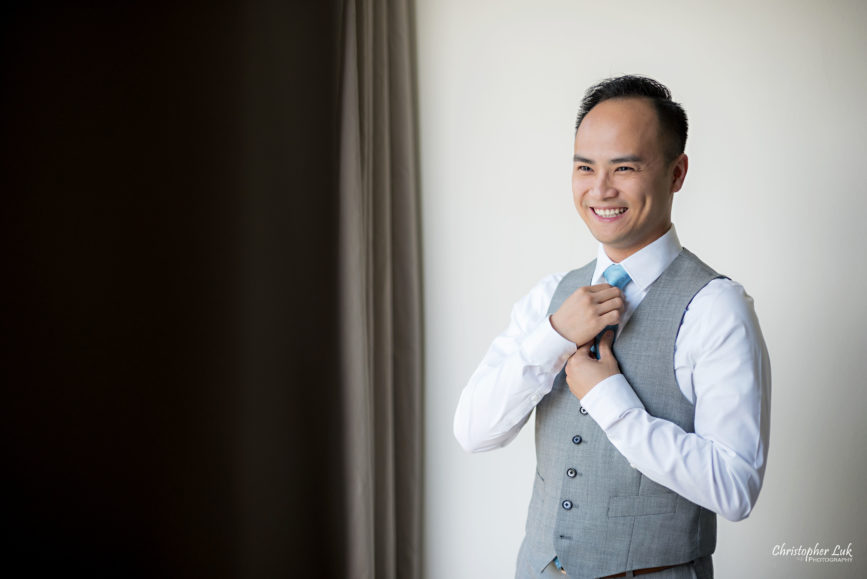 Christopher Luk - Toronto Wedding Lifestyle Event Photographer - Photojournalistic Natural Candid Hilton Suites Markham Groom Getting Ready Indochino Suit Grey Vest Tie