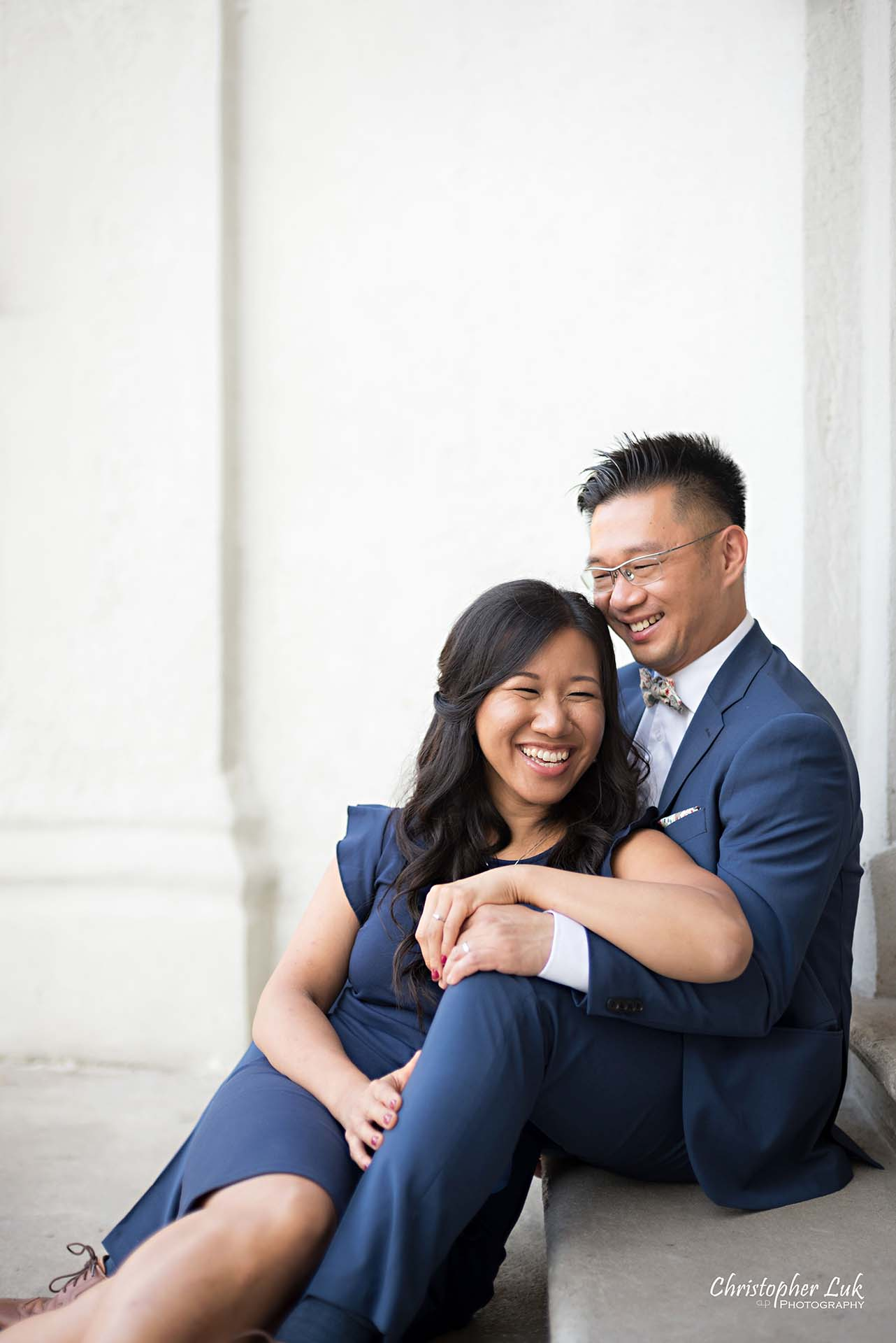 Christopher Luk Toronto Wedding Photographer - Engagement Photography - Sunnyside Pavilion Park Beach Boardwalk Toronto - Bride and Groom Natural Candid Photojournalistic Steps Staircase Hug Hold Laugh