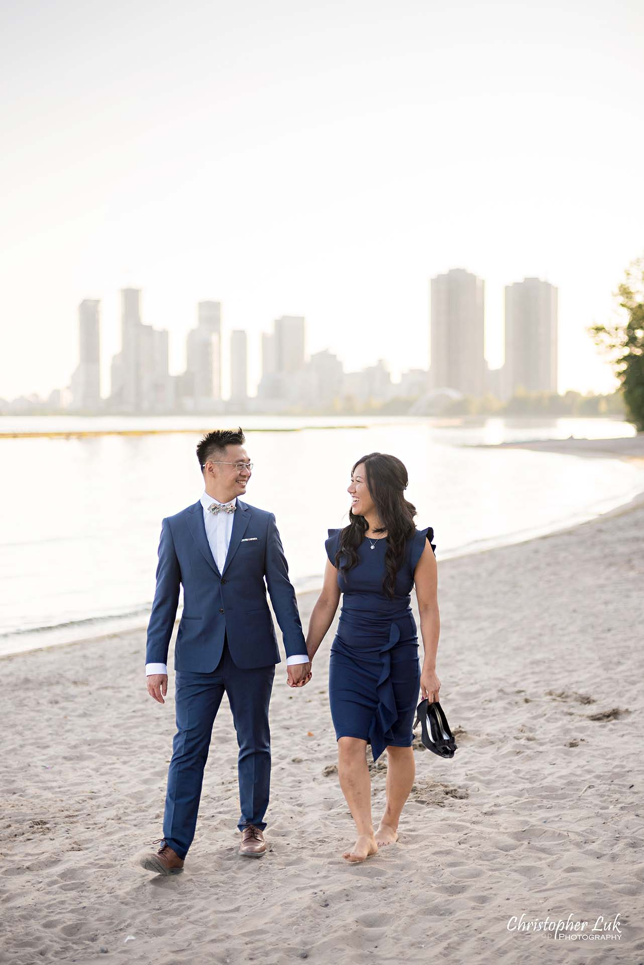 Christopher Luk Toronto Wedding Photographer - Engagement Photography - Sunnyside Pavilion Park Beach Boardwalk Toronto - Bride and Groom Natural Candid Photojournalistic Humber Bay Archway Arch Bridge Skyline Walking Vertical
