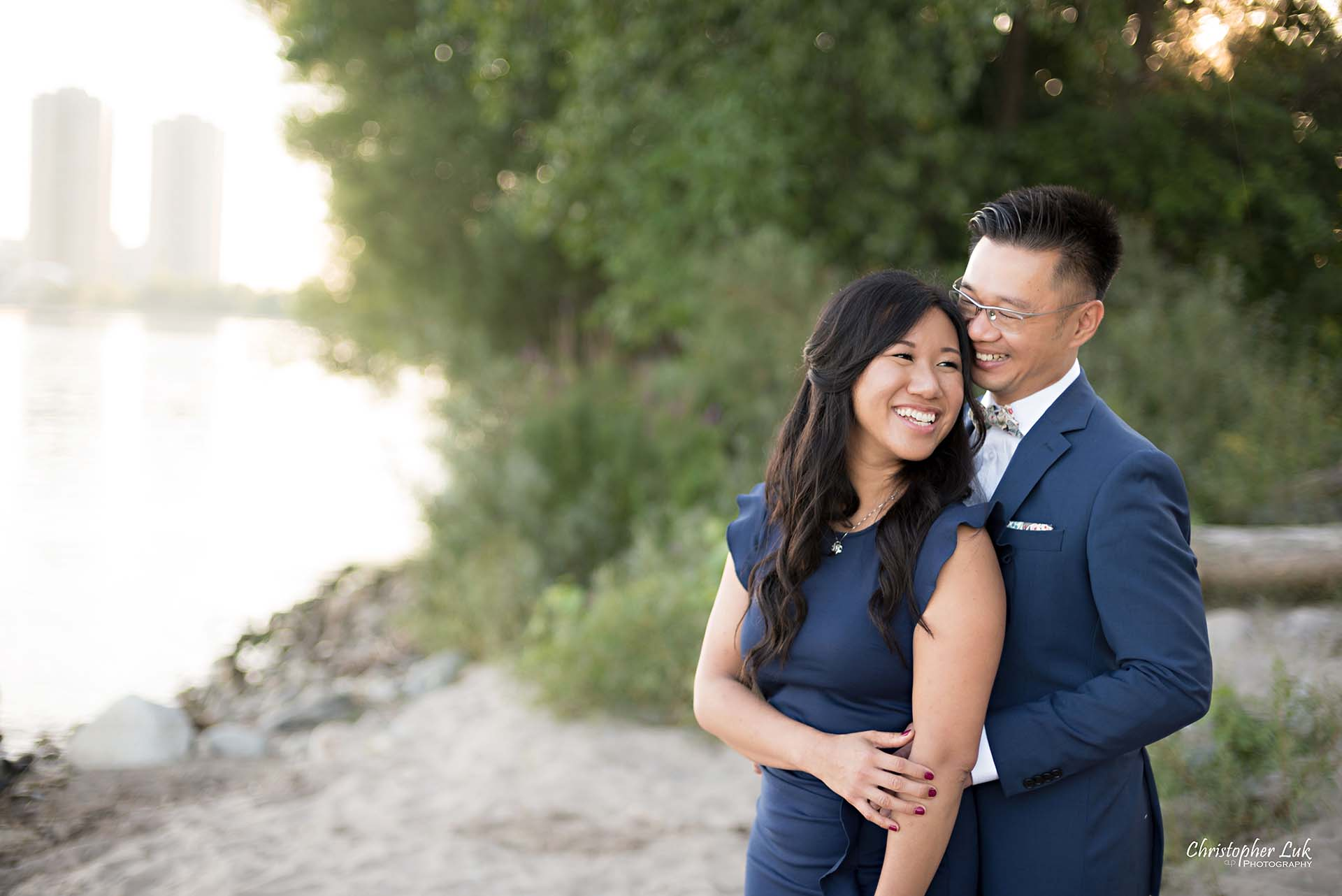 Christopher Luk Toronto Wedding Photographer - Engagement Photography - Sunnyside Pavilion Park Beach Boardwalk Toronto - Bride and Groom Natural Candid Photojournalistic Hug Smile Trees Close Love