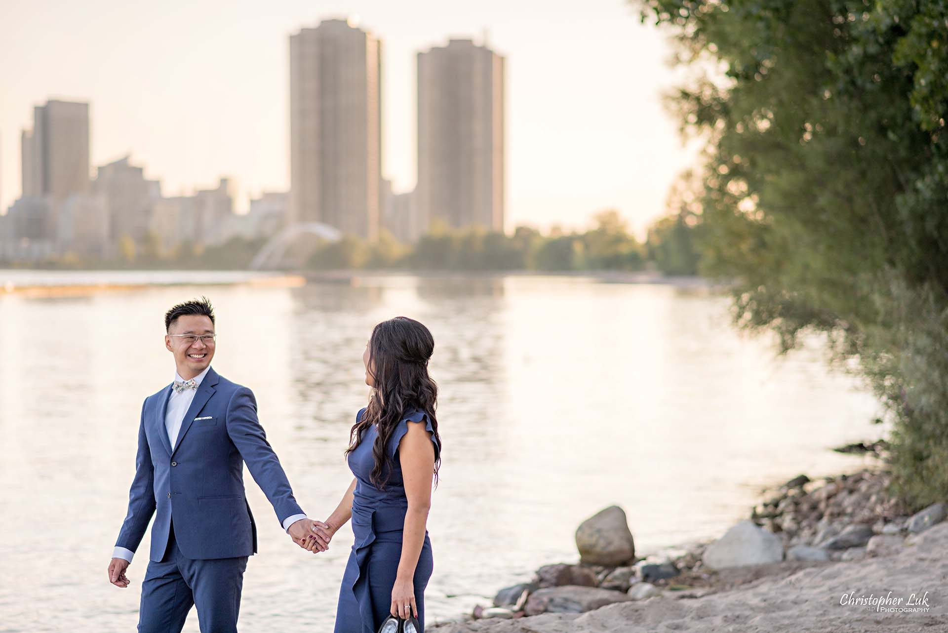 Christopher Luk Toronto Wedding Photographer - Engagement Photography - Sunnyside Pavilion Park Beach Boardwalk Toronto - Bride and Groom Natural Candid Photojournalistic Humber Bay Archway Arch Bridge Skyline Walking Smile