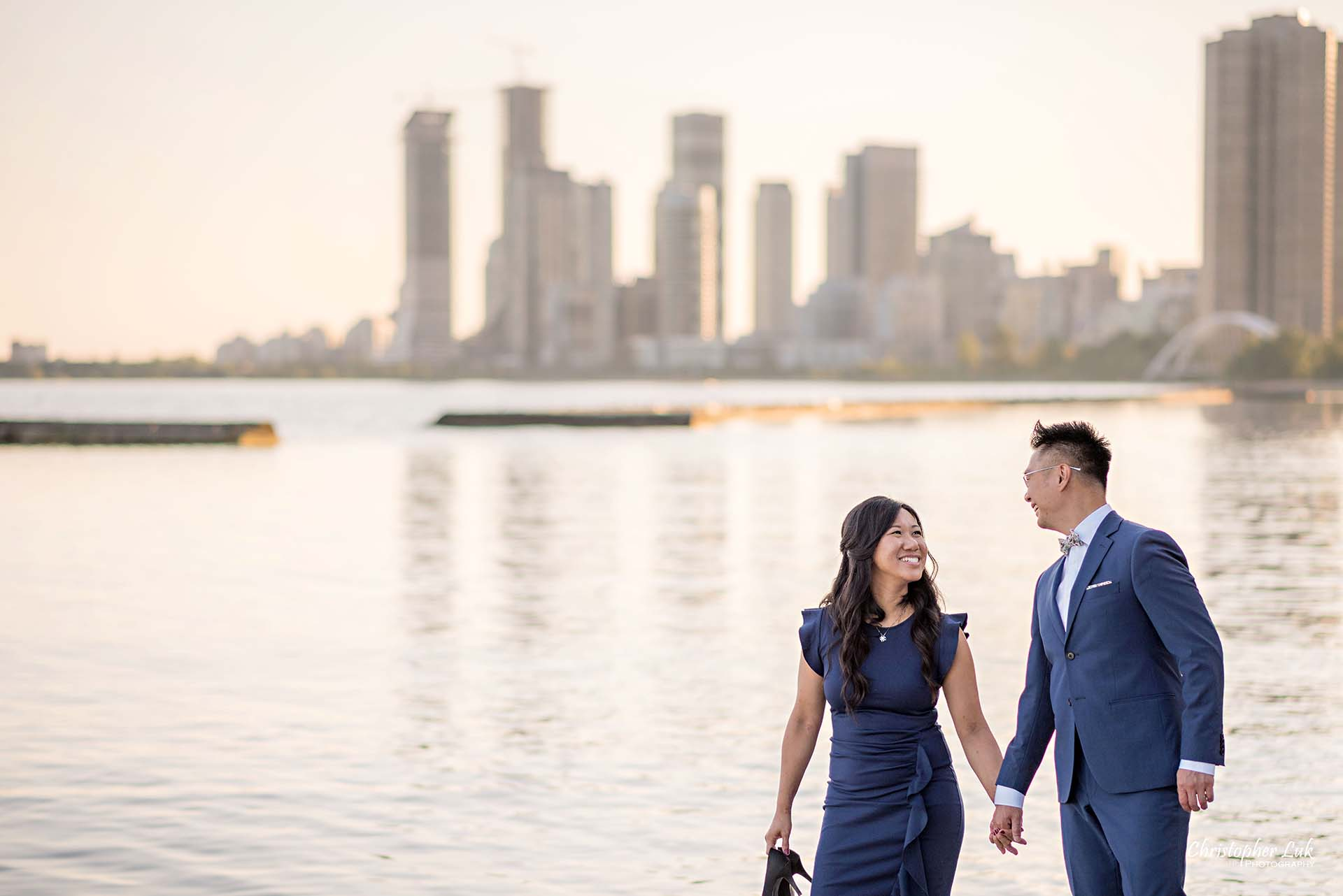 Christopher Luk Toronto Wedding Photographer - Engagement Photography - Sunnyside Pavilion Park Beach Boardwalk Toronto - Bride and Groom Natural Candid Photojournalistic Humber Bay Archway Arch Bridge Skyline Walking Smile Edge