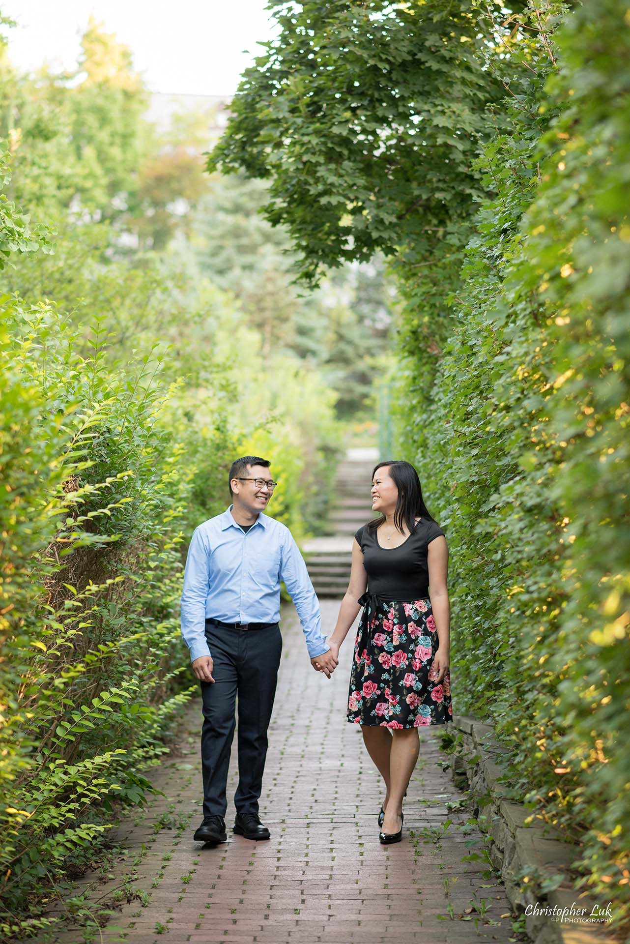Christopher Luk Toronto Wedding Family Event Corporate Commercial Headshot Photographer Edith Jeff Engagement Session Alexander Muir Memorial Gardens Park MidTown Photo Location Natural Candid Photojournalistic - Bride and Groom Walking Forest Pathway Path Walking Together