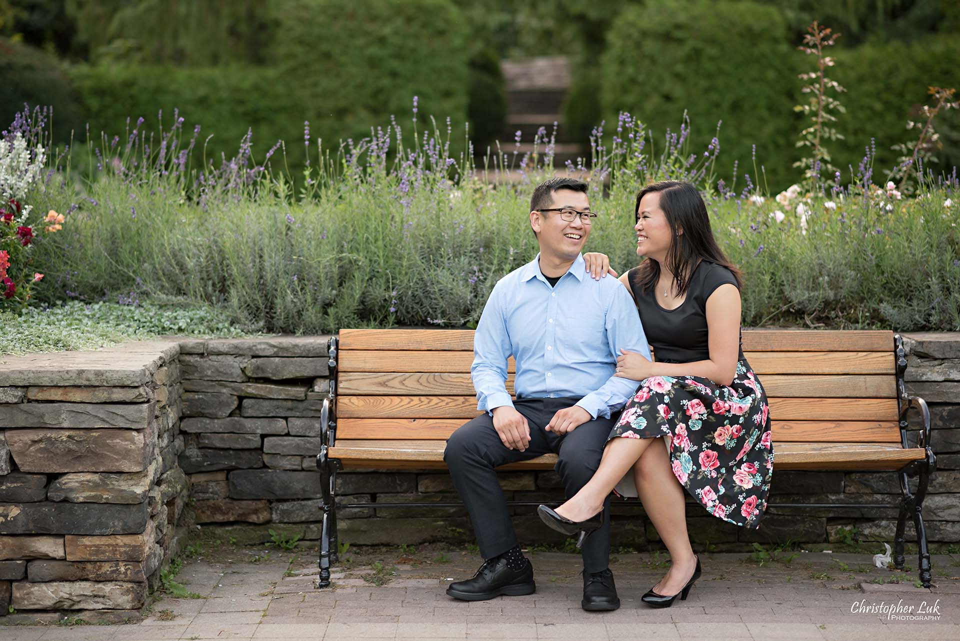 Christopher Luk Toronto Wedding Family Event Corporate Commercial Headshot Photographer Edith Jeff Engagement Session Alexander Muir Memorial Gardens Park MidTown Photo Location Natural Candid Photojournalistic - Bride and Groom Bench Sitting Talking Laughing