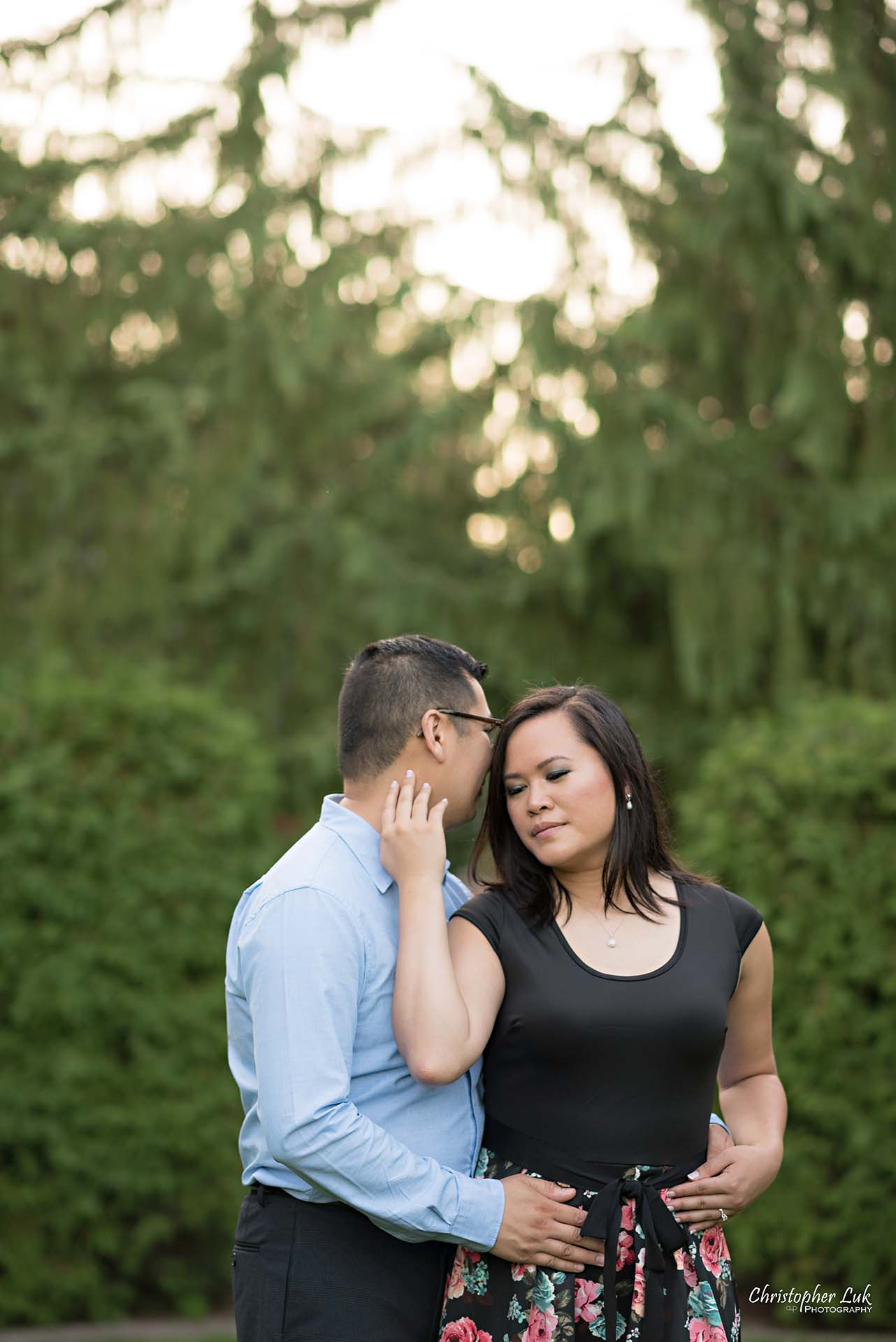 Christopher Luk Toronto Wedding Family Event Corporate Commercial Headshot Photographer Edith Jeff Engagement Session Alexander Muir Memorial Gardens Park MidTown Photo Location Natural Candid Photojournalistic - Bride and Groom Holding Each Other Together Sweet Quiet Moment