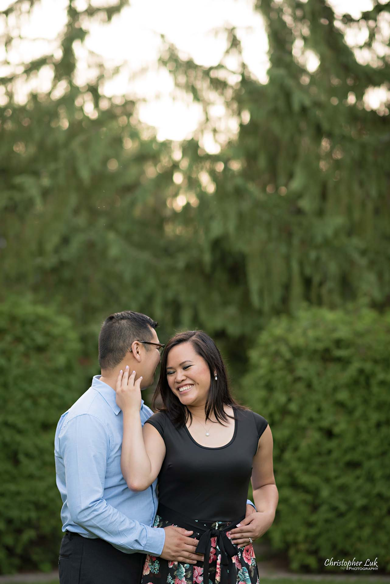 Christopher Luk Toronto Wedding Family Event Corporate Commercial Headshot Photographer Edith Jeff Engagement Session Alexander Muir Memorial Gardens Park MidTown Photo Location Natural Candid Photojournalistic - Bride and Groom Holding Each Other Together Sweet Smile Laugh