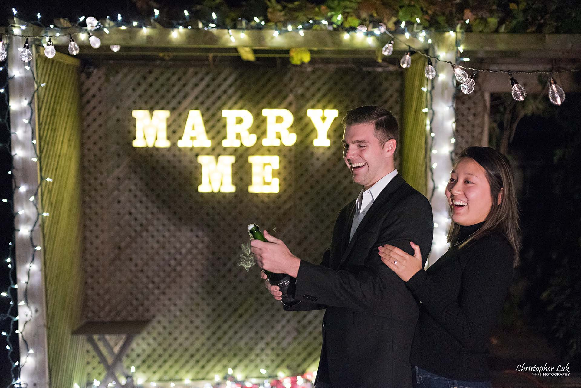 Christopher Luk Toronto Wedding Photographer - Backyard Surprise Proposal Engaged Engagement Gazebo Christmas Fairy Twinkle Lights Flower Petals Marry Me Natural Candid Photojournalistic - Bride and Groom Champagne