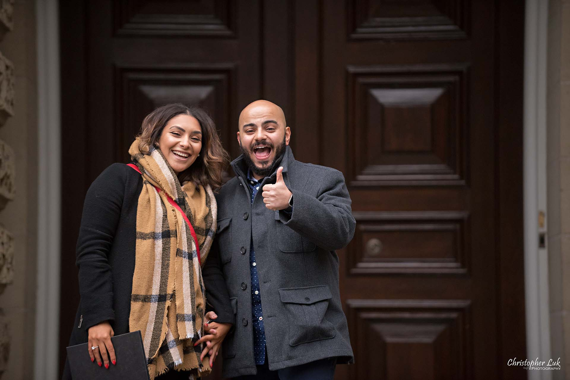 Christopher Luk Toronto Wedding Photographer - Toronto Osgoode Hall Surprise Proposal Engaged Engagement Will You Marry Me She Said Yes Natural Candid Photojournalistic - Fiancé Fiancée Bride Groom Celebrate Congratulations Thumbs Up