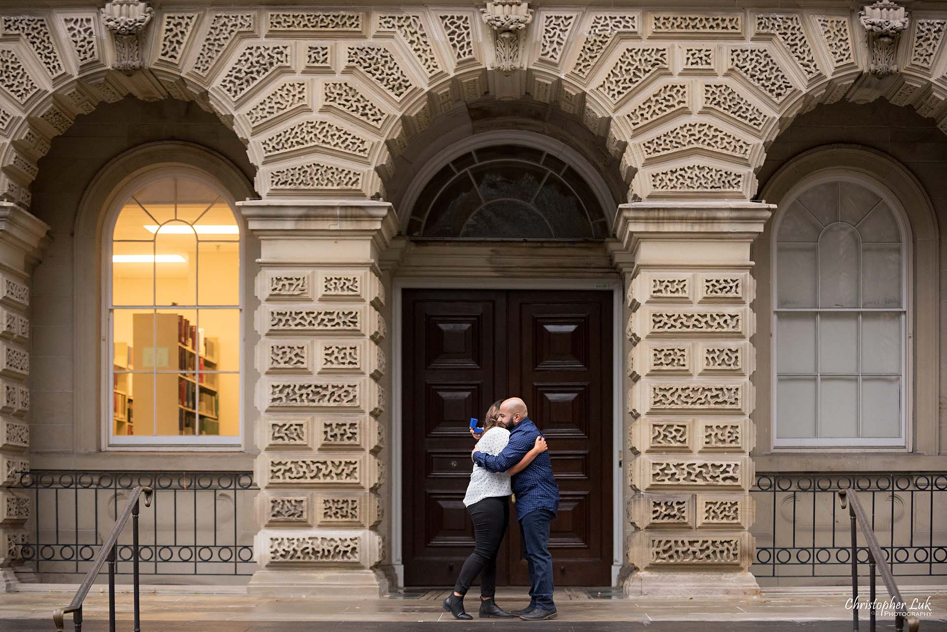 Christopher Luk Toronto Wedding Photographer - Toronto Osgoode Hall Surprise Proposal Engaged Engagement Will You Marry Me She Said Yes Natural Candid Photojournalistic - Fiancé Fiancée Bride Groom Ring Hug