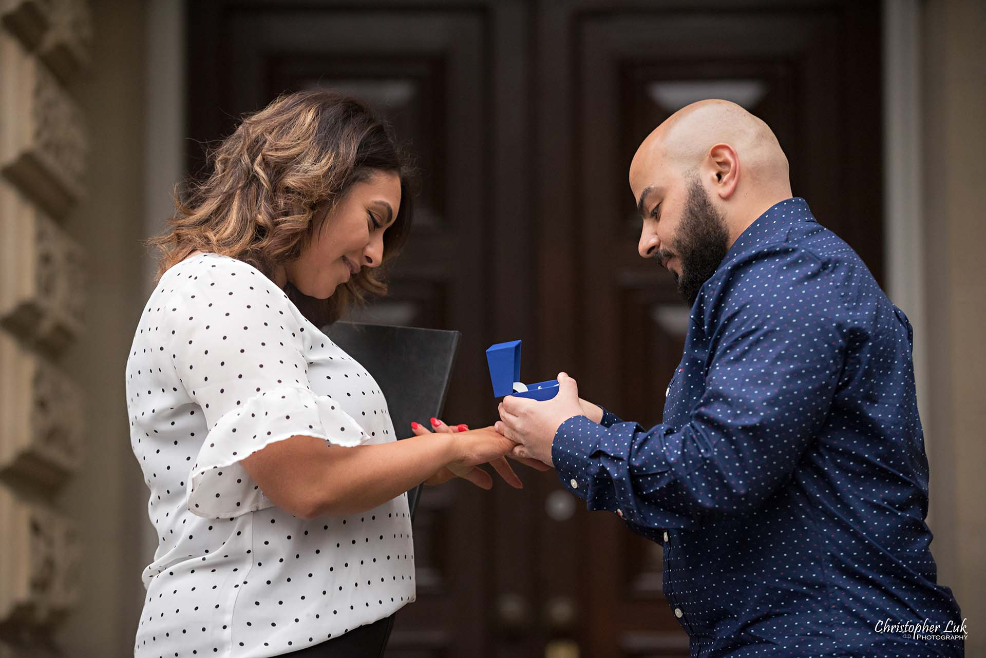 Christopher Luk Toronto Wedding Photographer - Toronto Osgoode Hall Surprise Proposal Engaged Engagement Will You Marry Me She Said Yes Natural Candid Photojournalistic - Fiancé Fiancée Bride Groom Ring Put On