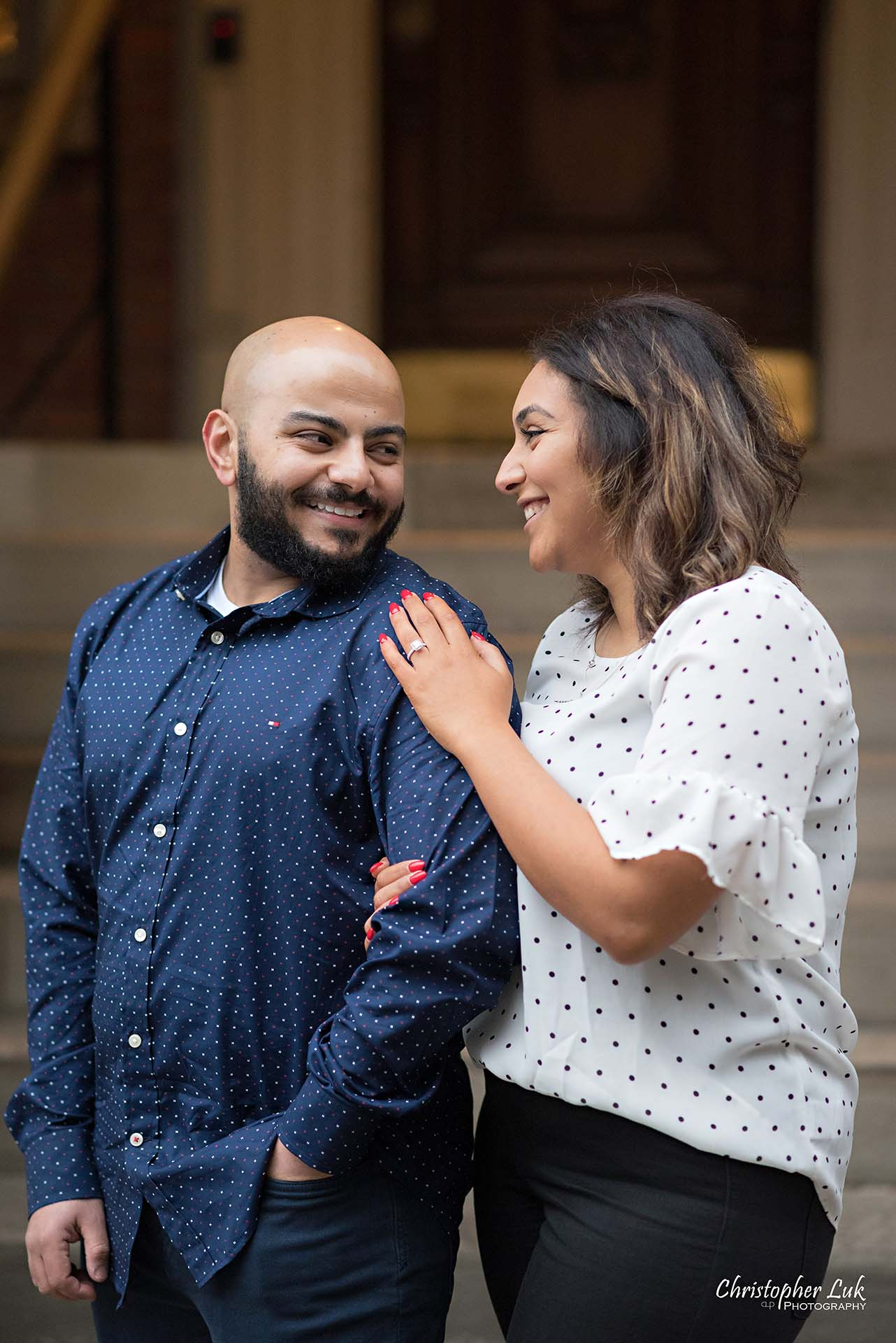 Christopher Luk Toronto Wedding Photographer - Toronto Osgoode Hall Surprise Proposal Engaged Engagement Will You Marry Me She Said Yes Natural Candid Photojournalistic - Fiancé Fiancée Bride Groom Hug Arm