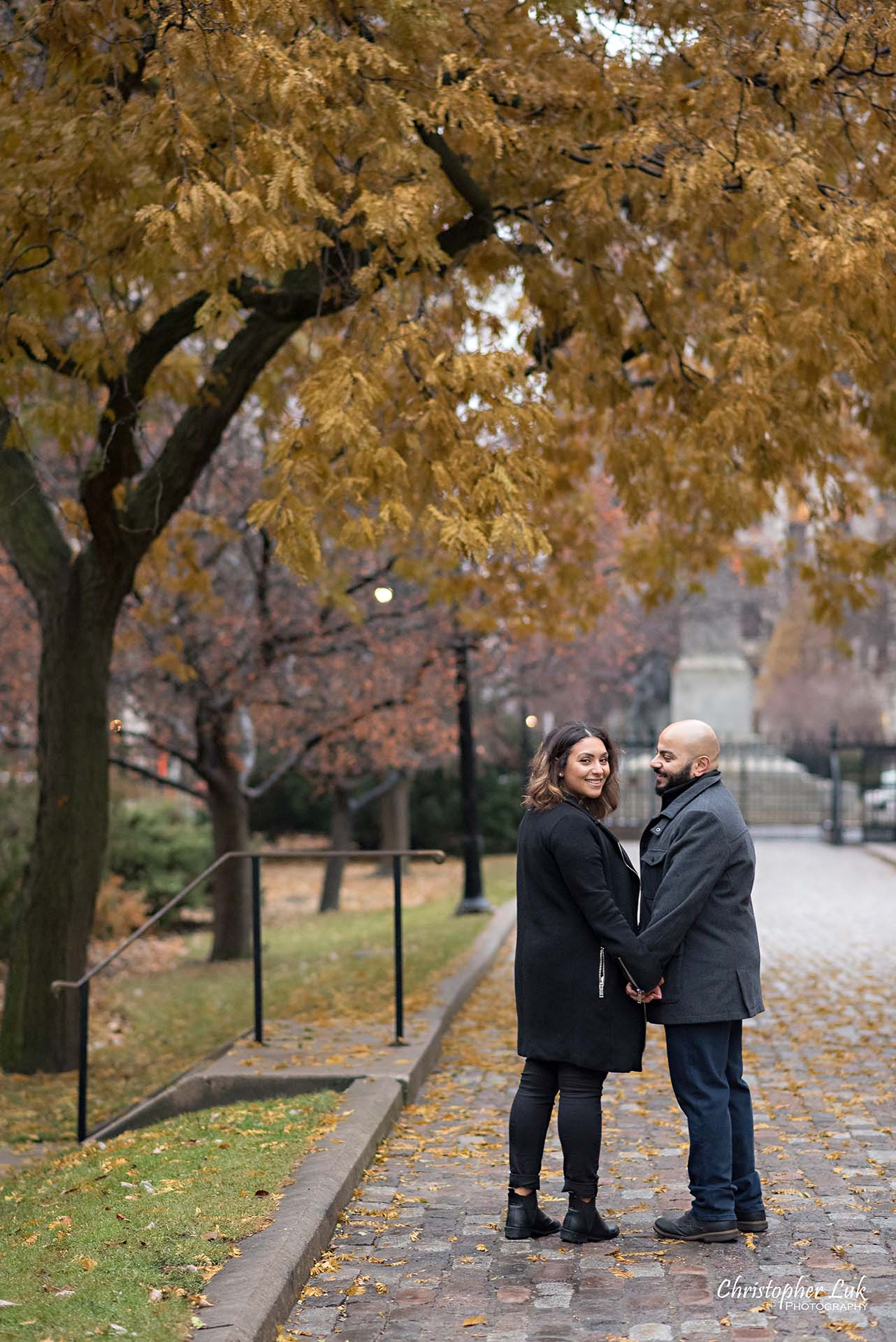 Christopher Luk Toronto Wedding Photographer - Toronto Osgoode Hall Surprise Proposal Engaged Engagement Will You Marry Me She Said Yes Natural Candid Photojournalistic - Fiancé Fiancée Bride Groom Walking Autumn Fall Leaves Her