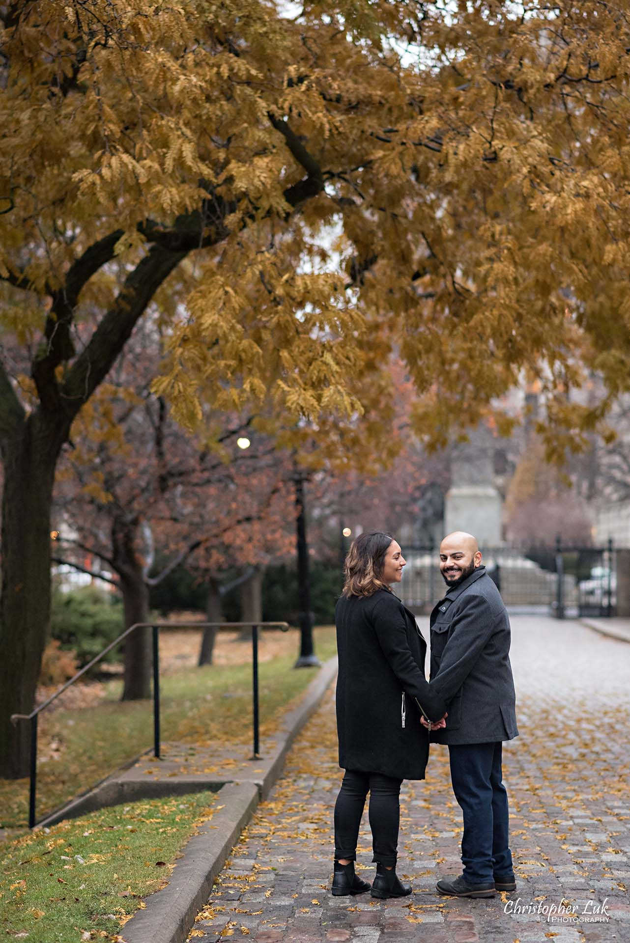 Christopher Luk Toronto Wedding Photographer - Toronto Osgoode Hall Surprise Proposal Engaged Engagement Will You Marry Me She Said Yes Natural Candid Photojournalistic - Fiancé Fiancée Bride Groom Walking Autumn Fall Leaves Him
