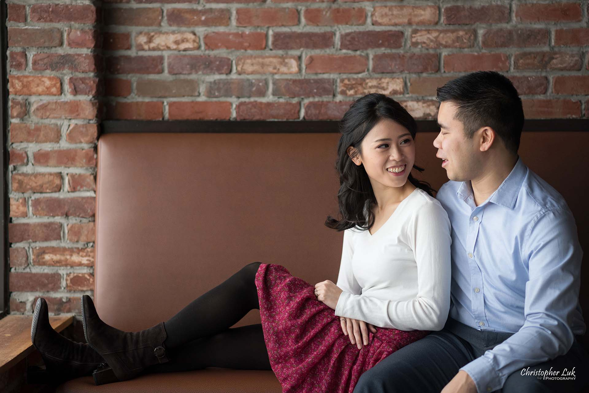 Christopher Luk Toronto Wedding Photographer - Richmond Hill Markham York Region Cafe Coffee Shop Bistro Winter Indoor Engagement PreWedding Natural Candid Photojournalistic Bride Groom Hug Rustic Brick Wall Bench Booth Sitting Together