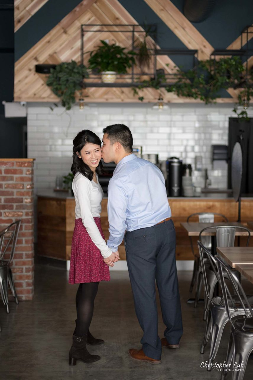Christopher Luk Toronto Wedding Photographer - Richmond Hill Markham York Region Cafe Coffee Shop Bistro Winter Indoor Engagement PreWedding Rustic Natural Candid Photojournalistic Bride Groom Walking Together Kiss